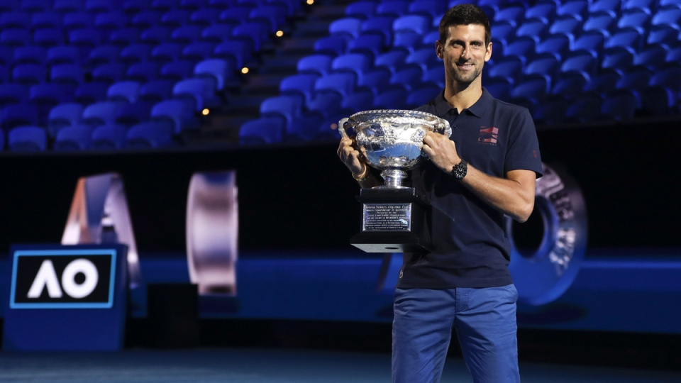 Defending men's singles champion Serbia's Novak Djokovic holds the Norman Brookes Challenge Cup during the official draw ceremony on Margaret Court Arena ahead of the Australian Open tennis championship, on Jan. 16, 2020. (Mark Baker / AP)