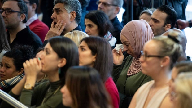 Students and community members attend a ceremony at Carleton University to honour biology PhD student Fareed Arastech and biology alumnus Mansour Pourjam, who died in the crash of Ukraine International Airlines Flight PS752 in Tehran, in Ottawa, on Wednesday, Jan. 15, 2020. THE CANADIAN PRESS/Justin Tang