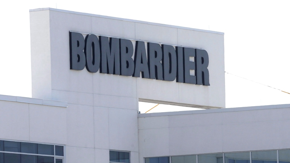 Flags fly outside a Bombardier plant in Montreal, on May 14, 2015. THE CANADIAN PRESS/Ryan Remiorz