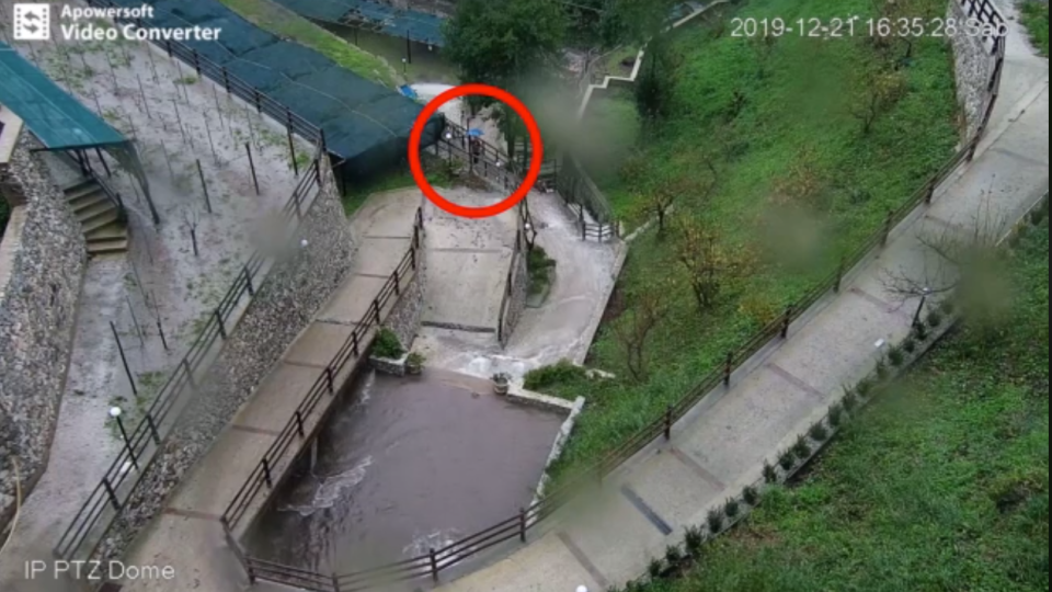 A person circled in red on CCTV footage can be seen standing in a terraced area of Cetara, Italy, moments before a landslide slammed into where they had recently vacated. (Protezione Civile Regione Campania/Facebook)