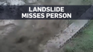 Person walks away moments before landslide