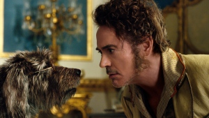 "This image released by Universal Pictures shows Dr. John Dolittle, portrayed by Robert Downey Jr., right, with Jip, voiced by Tom Holland, in a scene from ""Dolittle."" (Universal Pictures via AP)"