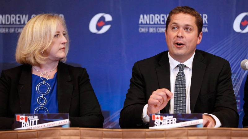 Conservative Party of Canada leader Andrew Scheer speaks, as Lisa Raitt listens in, at his shadow cabinet meeting in Winnipeg, Wednesday, September 6, 2017. THE CANADIAN PRESS/John Woods