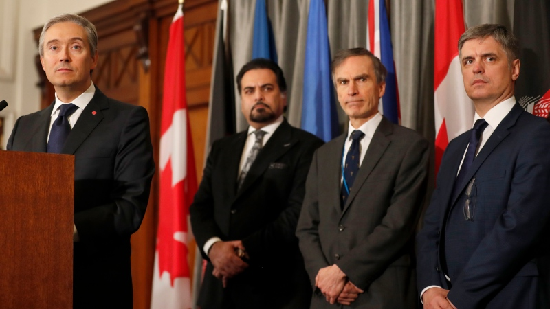 François-Philippe Champagne, Canada Minister of Foreign Affairs, from left, Afghanistan Minister of Foreign Affairs Idrees Zaman, British MP Andrew Murrison and Ukraine's Minister of Foreign Affairs Vadym Prystaiko listen during a press conference after a meeting of the International Coordination and Response Group for the families of the victims of PS752 flight that crashed shortly after taking off from the Iranian capital Tehran on Jan. 8, killing all 176 passengers and crew on board.(AP Photo/Frank Augstein)