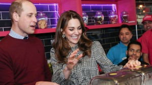 Prince William and Kate, Duchess of Cambridge help make Kulfi milkshakes at MyLahores flagship restaurant in Bradford, England, Wednesday, Jan. 15, 2020. (Chris Jackson/Pool Photo via AP)