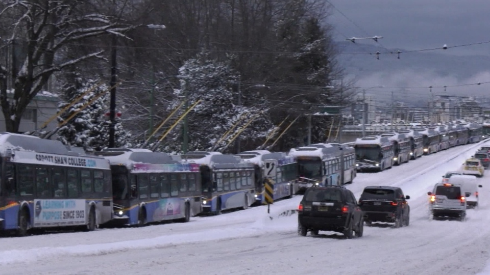 A long line of buses seen near the south end of the Granville Street bridge on Wednesday, Jan. 15, 2020.