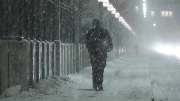 A person walks over a Metro Vancouver bridge in the snow on Wednesday, Jan. 15, 2020.
