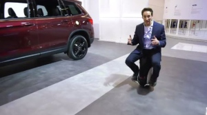 Rob Lurie takes a spin on the Honda UNI-CUB at the Montreal Auto Show.