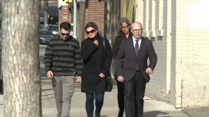 Cpl. Colin Magee (far right) walks into court