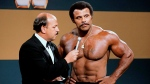 In this undated photo provided by WWE, Inc., 'Mean' Gene Okerlund interviews Rocky 'Soul Man' Johnson. Johnson, a WWE Hall of Fame wrestler who became better known as the father of actor Dwayne 'The Rock' Johnson, died Wednesday, Jan. 15, 2020. He was 75. (WWE, Inc. via AP)