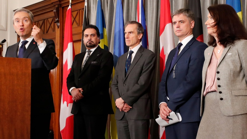 Francois-Philippe Champagne, Canada Minister of Foreign Affairs, from left, Afghanistan Minister of Foreign Affairs Idrees Zaman, British MP Andrew Murrison, Ukraine's Minister of Foreign Affairs Vadym Prystaiko and Sweden's Minister for Foreign Affairs Ann Linde listen during a press conference after a meeting of the International Coordination and Response Group for the families of the victims of PS752 flight that crashed shortly after taking off from the Iranian capital Tehran on Jan. 8, killing all 176 passengers and crew on board.(AP / Frank Augstein)