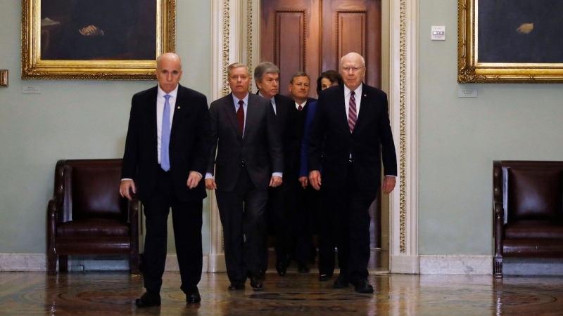 Supreme Court Chief Justice John Roberts is escorted by Sen. Lindsey Graham, R-S.C., center left, Sen. Patrick Leahy, D-Vt., right, Sen. Dianne Feinstein, D-Calif., and Sen. Roy Blunt, R-Mo., toward the Senate chamber at the U.S. Capitol in Washington, Thursday, Jan. 16, 2020. (AP / Matt Rourke)