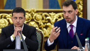 The office of Zelenskiy (L) office said it had received the letter of resignation from Goncharuk (R) and would consider it. (AFP)