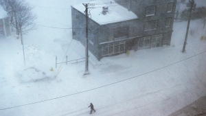 A man walks down the middle of New Gower St. in St. John's as a major winter storm hits the Avalon Peninsula on Friday, January 17, 2020. THE CANADIAN PRESS/Andrew Vaughan