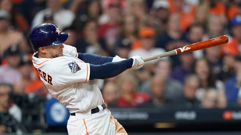In this Oct. 22, 2019, file photo, Houston Astros' George Springer hits a home run during the seventh inning of Game 1 of the baseball World Series against the Washington Nationals in Houston. (AP Photo/David J. Phillip)