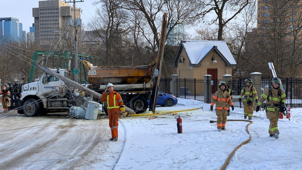 A hydro pole is down across a salt truck in central London, Ont. on Friday, Jan. 17, 2020. (Source: London Fire Department)