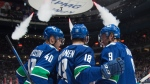 Vancouver Canucks right wing Jake Virtanen (18) celebrates his goal against the Arizona Coyotes with teammates Elias Pettersson (40) J.T. Miller (9) during second period NHL action in Vancouver, Thursday, January 16, 2020. THE CANADIAN PRESS/Jonathan Hayward
