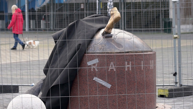 A black cloth used to hide the vandalized statue of Zlatan Ibrahimovic uncovers a bronze foot from the block of stone, outside the stadium of Malmo's soccer team in Malmo, Sweden, on Jan. 16, 2020. (David Keyton / AP)