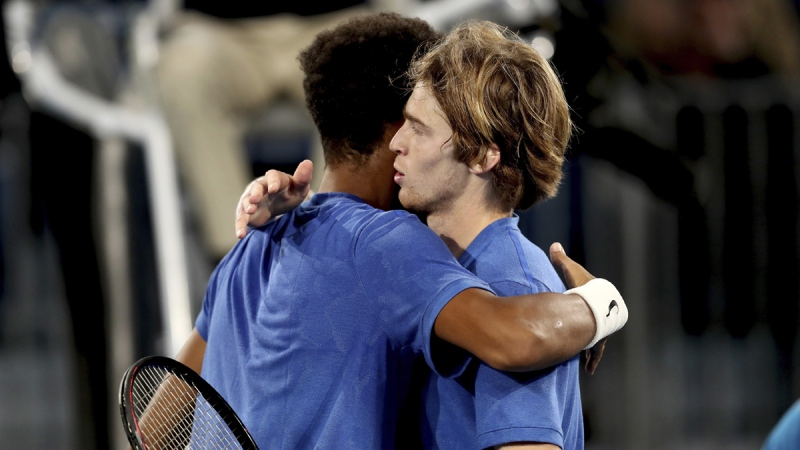 Russia's Andrey Rublev celebrates winning against Canada's Felix Auger-Aliassime during their Adelaide International tennis match in Adelaide, Australia, on Jan. 17, 2020. (James Elsby / AP)