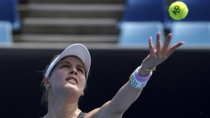 Eugenie Bouchard serves at the Australian Open tennis championship in Melbourne, Australia, on Jan. 17, 2020. (Lee Jin-man / AP)