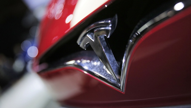 The logo of a Tesla model S at the Paris Auto Show in Paris, France, on Sept. 30, 2016.  (Christophe Ena / AP)