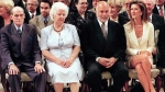Singer Celine Dion is joined by her parents Adhemar and Therese as well as her husband Rene Anglil(left to right) for her investiture into the Order of Canada in Ottawa Friday.(CP PHOTO) 1998