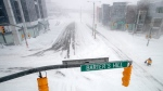 A pedestrian braves extreme conditions as he walks in St. John's on Friday, Jan. 17, 2020. THE CANADIAN PRESS/Andrew Vaugha
