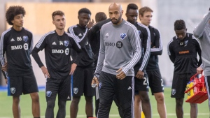 Montreal Impact head coach Thierry Henry, centre, conducts his first practice Tuesday, January 14, 2020 in Montreal. The Impact will play five preparatory matches in Florida. THE CANADIAN PRESS/Ryan Remiorz