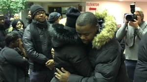 Uche Osagie embraced by community members at candlelight vigil for her three children killed in a tragic car crash. Jan. 16, 2020 (Dana Roberts/CTV Northern Ontario)