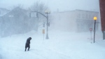 A woman makes her way through the snow-covered streets in St. John's on Friday, Jan. 17, 2020. THE CANADIAN PRESS/Andrew Vaughan