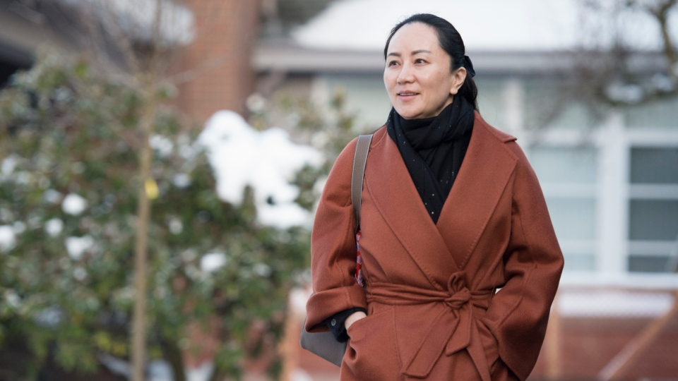 Meng Wanzhou chief financial officer of Huawei leaves her home in Vancouver, B.C., Friday, January 17, 2020 as she heads to B.C. Supreme Court for a case management hearing. (THE CANADIAN PRESS/Jonathan Hayward)