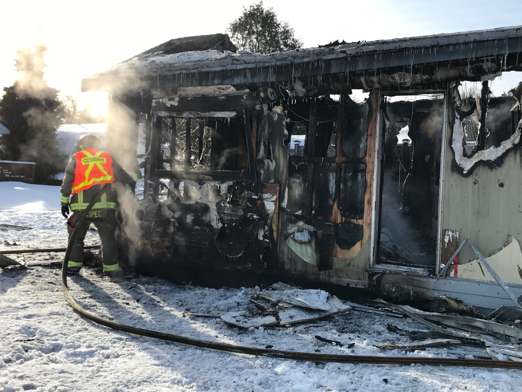 Sudbury firefighter douses mobile home