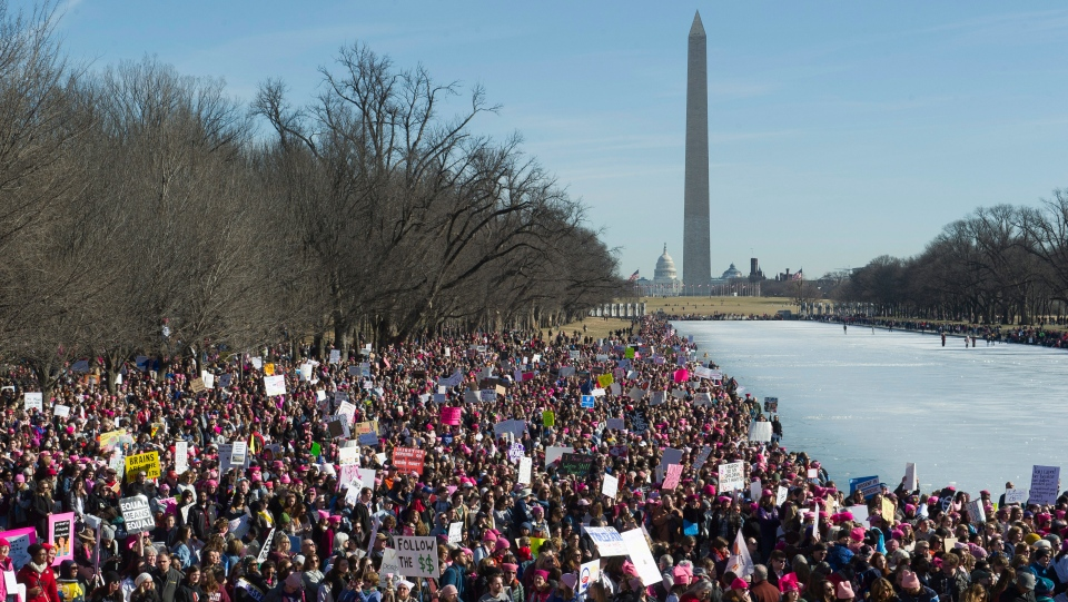 In this Jan. 20, 2018, file photo, participants in the Women's March gather near the Lincoln Memorial in Washington. (AP Photo/Cliff Owen, File)