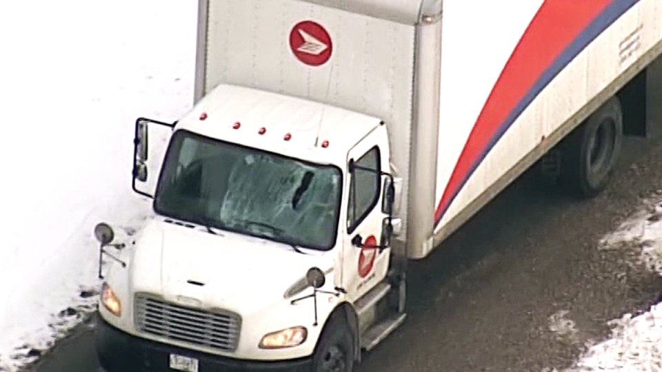 A damaged Canada Post truck is parked near the Massey Tunnel on Friday, Jan. 17, 2020.