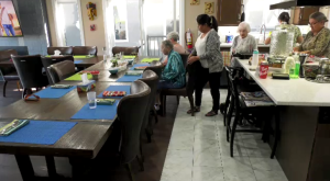 Residents having lunch at Warm 'n' Cozy Care home. (Chad Hills/CTV News Saskatoon)