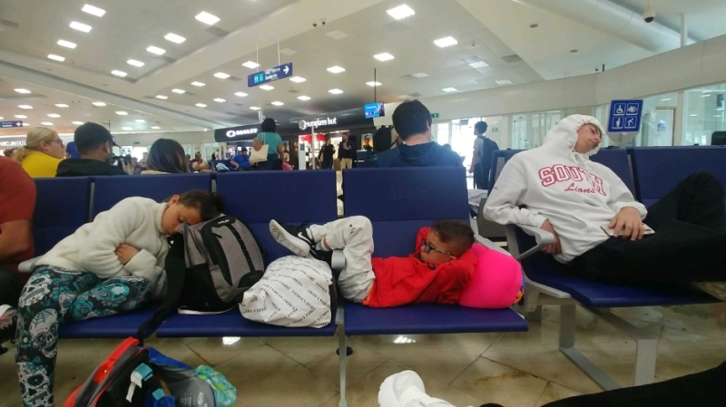Dana and Russ Graves' children sleep at the airport in Mexico as they await their return in this family photo.