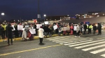 The bitter cold and wind didn't deter dozens of protesters, who were there in response to assault allegations made by a woman inside the Mumford Road Walmart on Wednesday. (CTV ATLANTIC/JIM KVAMMEN)