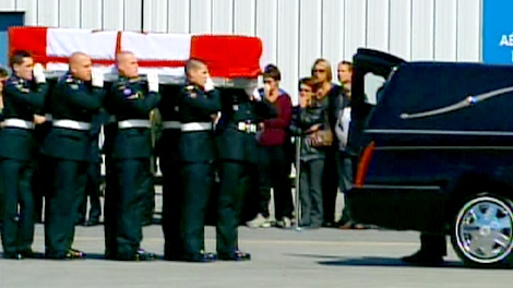 The casket for Pte. Patrick Lormand is carried to a hearse during his repatriation ceremony at CFB Trenton on Wednesday, Sept. 16, 2009.