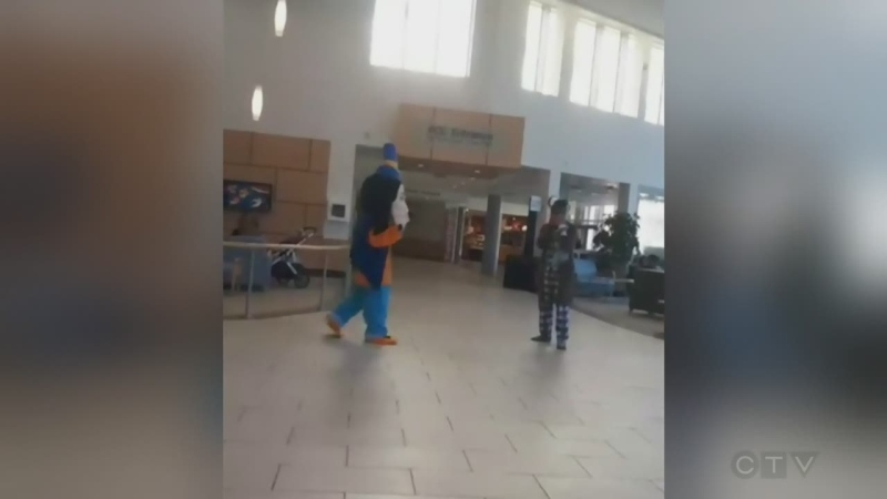 Adam finds out the story behind a surprise hospital visit caught on camera in Victoria, featuring a patient facing serious surgery and a woman dressed like Goofy.(CTV News)