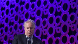 Jean Charest is seen during a panel discussion at the Canadian Aerospace Summit in Ottawa on November 13, 2019. THE CANADIAN PRESS/Adrian Wyld