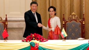 Myanmar's leader Aung San Suu Kyi, right, and Chinese President Xi Jinping, left, shake hands after the ceremony of signing a memorandum of understanding at the president house in Naypyitaw Myanmar, Saturday, Jan. 18, 2020. (Nyein Chan Naing/Pool Photo via AP)