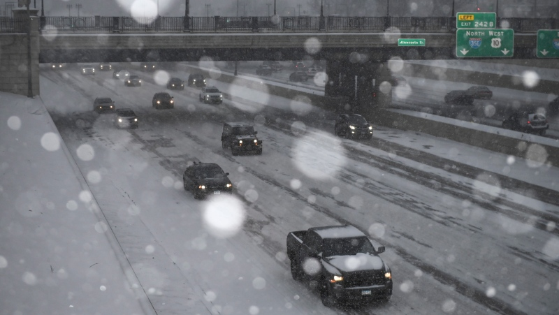 Snow falls during the afternoon commute as motorists drive on the westbound I-94 Friday, Jan. 17, 2020 in St. Paul, Minn. A winter storm was pounding parts of the Upper Midwest with heavy snow and making travel treacherous Friday. (Aaron Lavinsky/Star Tribune via AP)