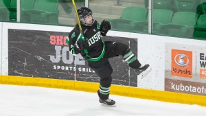 Defenseman Leah Bohlken celebrates during the University of Saskatchewan Huskies Women's hockey team's victory against the University of Calgary Dinos. (Photo by: Huskies Athletics)