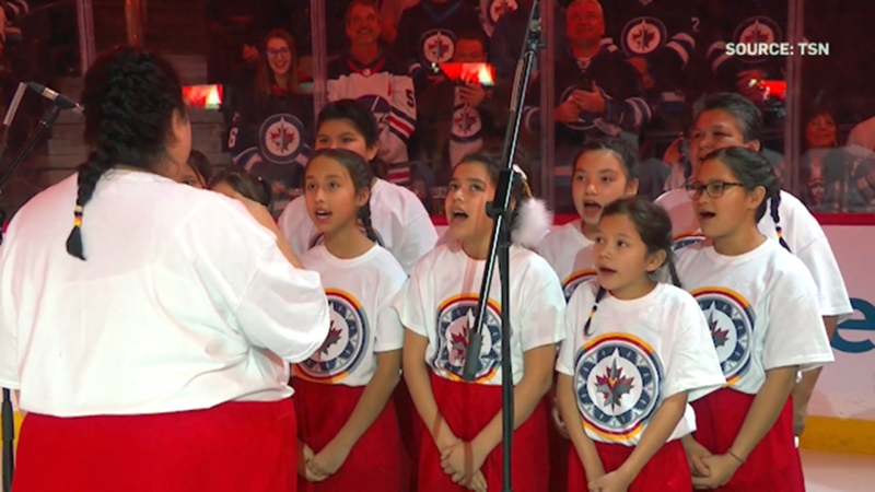 Indigenous choir sings 'O Canada' at Jets game