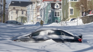 A half buried car is parked in St. John's on Saturday, January 18, 2020. THE CANADIAN PRESS/Andrew Vaughan