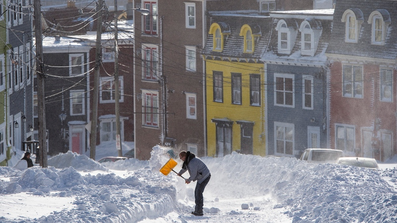 A resident digs a path from his house in St. John's on Saturday, January 18, 2020. THE CANADIAN PRESS/Andrew Vaughan