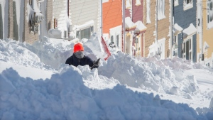 A resident digs out his walkway in St. John's on Saturday, January 18, 2020. THE CANADIAN PRESS/Andrew Vaughan