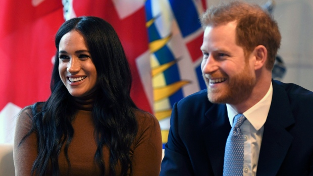 Prince Harry and Meghan, Duchess of Sussex smile during their visit to Canada House in thanks for the warm Canadian hospitality and support they received during their recent stay in Canada, in London, Jan. 7, 2020. (Daniel Leal-Olivas/Pool Photo via AP)