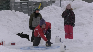 A family participates in milk jug curling in Timmins on Saturday Jan. 18. (Lydia Chubak/CTV Northern Ontario)