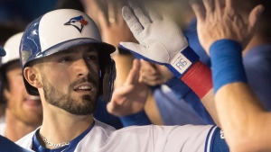 Toronto Blue Jays' Randal Grichuk celebrates with teammates in the dugout after hitting a three-run home run in first inning American League MLB baseball action against the Baltimore Orioles, in Toronto, Monday, Sept. 23, 2019. THE CANADIAN PRESS/Fred Thornhill
